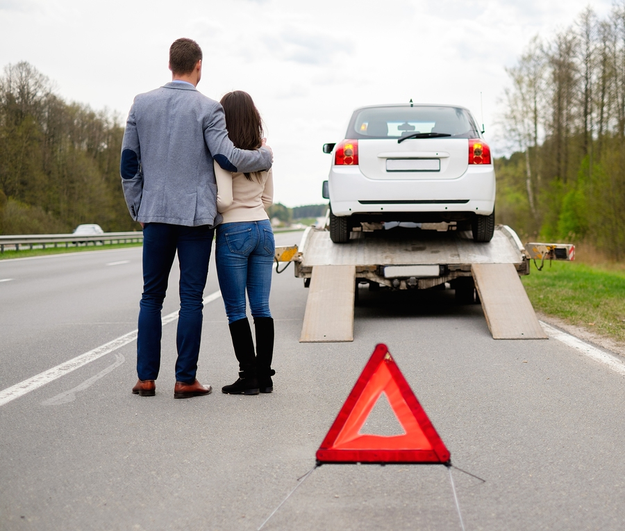a couple is having an emergency towing