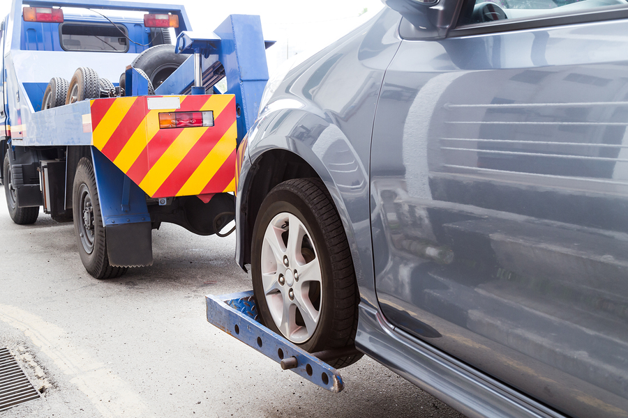 illegally parked car being towed away