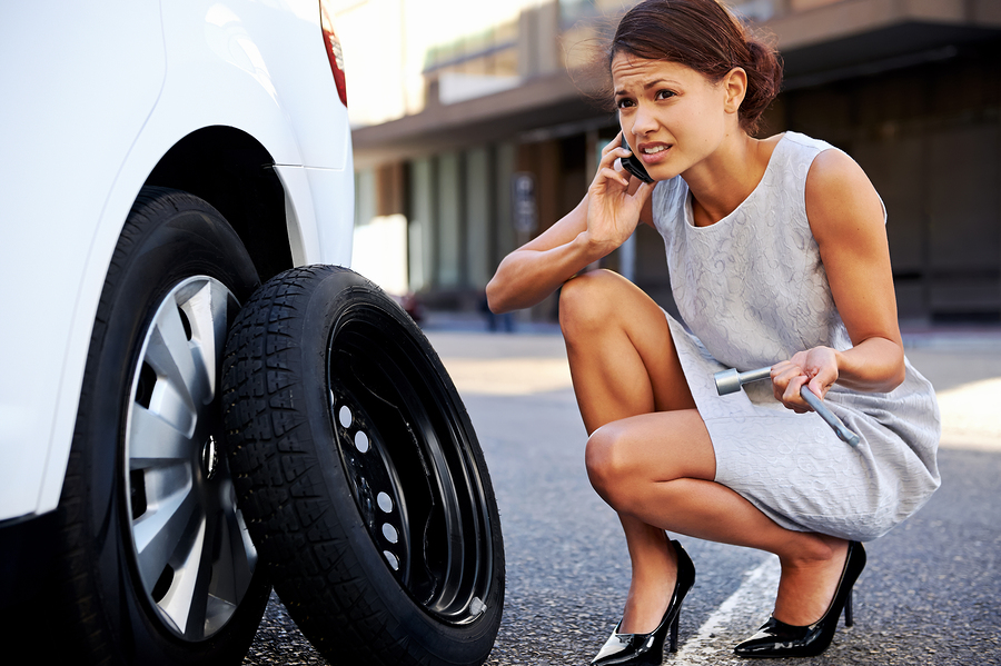 woman is looking for help with tire change