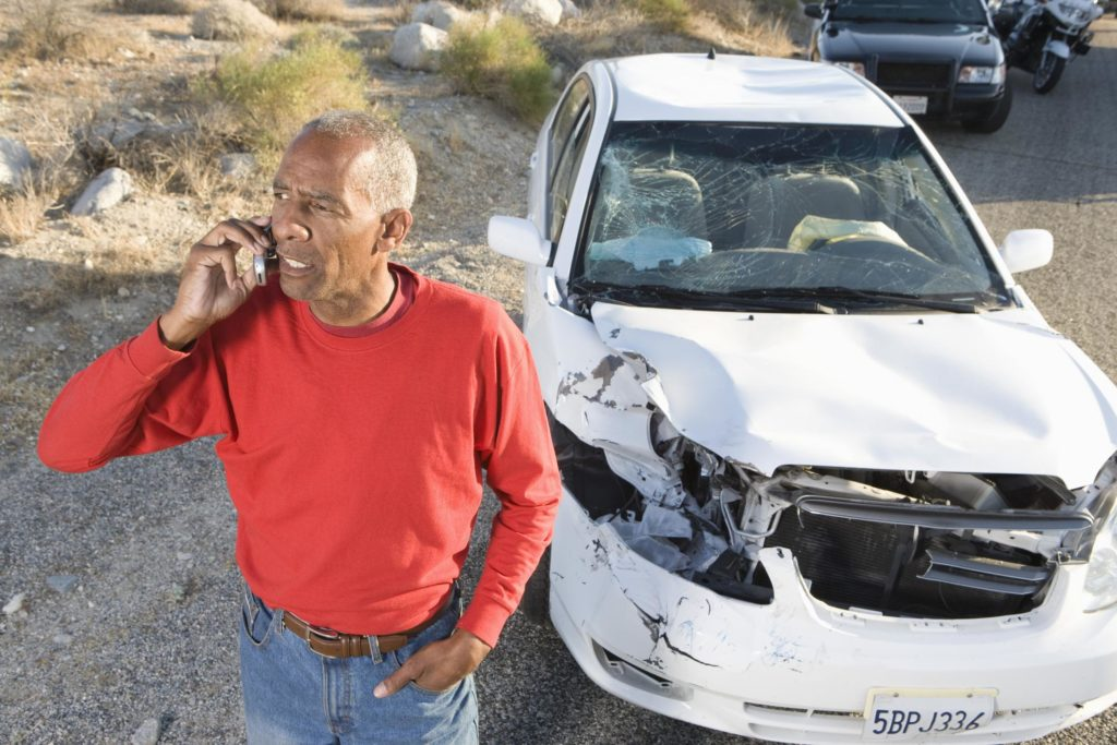 man is looking for roadside assistance